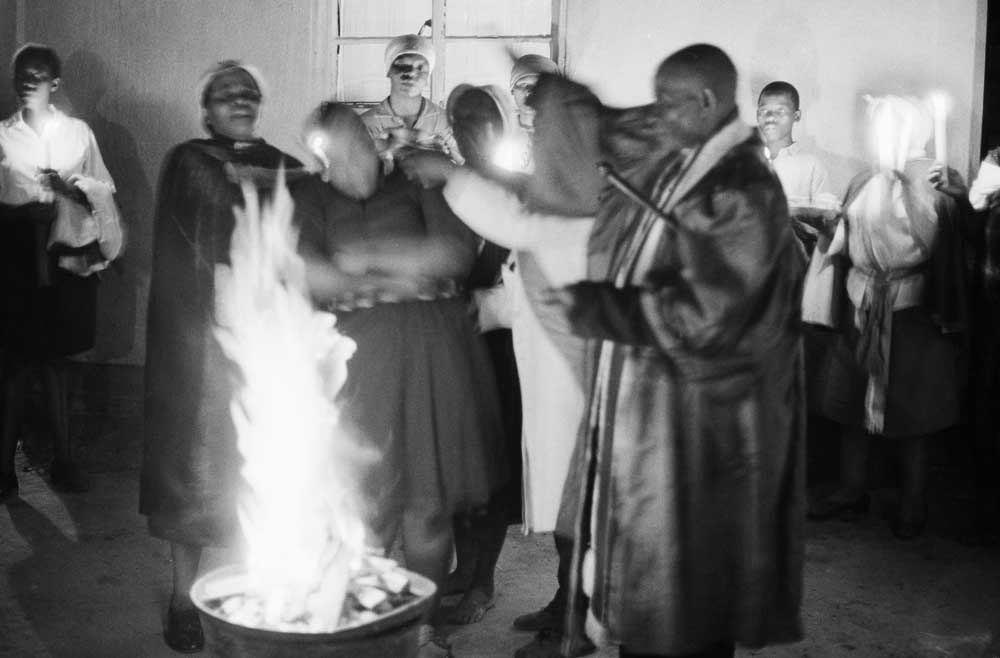 St Francis Church Bishop Nakeli praying over sacrificial fire